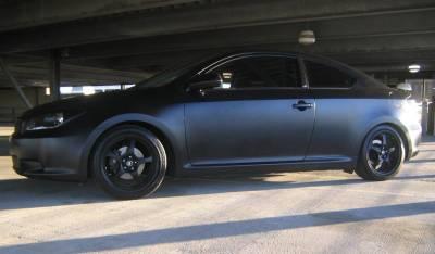 FastScions.com Customer Ride: 2006 Flat Black Scion tC 5-spd   Owner: Dawn Mathis Cover